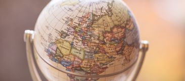 Journey: Close up of a globe. Close up of an old vintage globe, blurry background travel earth transport journey world vacation planning liberty adventure stock image