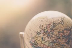 Journey: Close up of a globe. Close up of an old vintage globe, blurry background travel earth transport journey world vacation planning liberty adventure royalty free stock photos