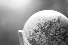 Journey: Close up of a globe. Close up of an old vintage globe, blurry background travel earth transport journey world vacation planning liberty adventure royalty free stock image