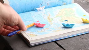 Journey concept. Travel , trip vacation or tourism concept, paper boats on the map stock video footage