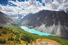 Journey on foot through the mountain valleys. Beauty of wildlife. Altai, the road to Shavlinsky lakes, Russia. Peaks of snowy Stock Images