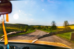 Journey through the green and yellow fields Stock Photos