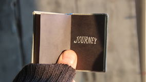 Journey idea,text on book. Journey idea, Guy traveler holding a book with an inscription stock video