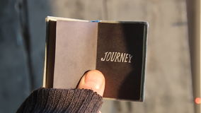 Journey idea,text on book. Journey idea, Guy traveler holding a book with an inscription stock video footage