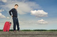 Journey. Little boy taking a beautiful journey royalty free stock image