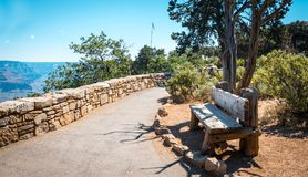 Bench on the path to the Grand Canyon Village. Sight place, view of Grand Canyon, Arizona Stock Photos