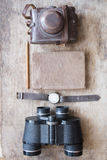 Journey planning idea. Tourist essentials. Objects on vintage table. Royalty Free Stock Photography