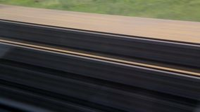 The journey by rail. Shot from the window of a moving train, railroad tracks, rails, sleepers.  stock video