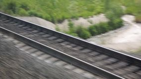 The journey by rail. Shot from the window of a moving train, railroad tracks, rails, sleepers.  stock footage