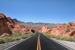 Journey Road. A long road that stretches out into the desert.This photo was taken at Valley of Fire National Park Royalty Free Stock Image