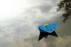 Journey on a ship under the flag of a flower Stock Photography
