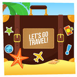 Journey suitcase on the beach Royalty Free Stock Photo