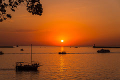 Journey into the sunset. Bright sunset, quiet bay, walk on a yacht at sunset Royalty Free Stock Image