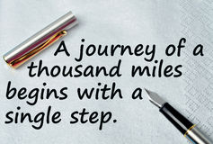 A journey of a thousand miles begins with a single step. On napkin Stock Image