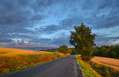 Journey to the east. Road stretching out to the east under the evening sky Stock Images