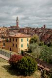 Journey to Italy. The narrow streets of Siena with colored houses stock images