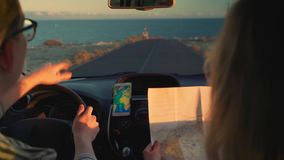 Travel by car to meet adventures on the sea coast in the rays of sunset stock video