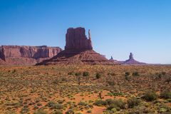 Drought in the southwest of the USA. Desert vegetation of Arizona and cliffs monuments. Journey to the southwest of the USA. Panorama of the Valley of Monuments royalty free stock photos