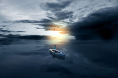 Journey towards light child in boat in waterscape sea Stock Photos