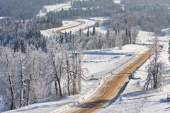 The journey in the winter forest. The view from mountains Royalty Free Stock Photography