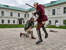 Joust on the territory of the monastery. Royalty Free Stock Images
