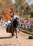 Jousting Champion Shane Adams. HARVEYSBURG OH,OCTOBER 9 2010- Jouster Shane Adams rides into the jousting arena to the cheers of the crowd at the Ohio Royalty Free Stock Photography
