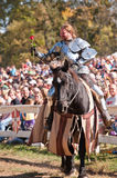Jousting Champion Shane Adams. HARVEYSBURG OH,OCTOBER 9 2010- Reigning world champion Jouster Shane Adams offers a rose to a fair maiden in the crowd before a Stock Images