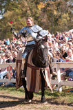 Jousting Champion Shane Adams. HARVEYSBURG OH,OCTOBER 9 2010- Reigning world champion Jouster Shane Adams offers a rose to a fair maiden before a jousting match Royalty Free Stock Photos