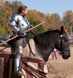 Jousting Champion Shane Adams. HARVEYSBURG OH,OCTOBER 9 2010- Reigning World Champion full-contact Jouster, Shane Adams waits on horseback for a jousting game to Stock Photos