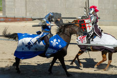 Jousting duel of two knights against each other. BOISE, IDAHO - AUGUST 19: Close call between the blue knight and the red knight while jousting at the Idaho Fair Royalty Free Stock Photos