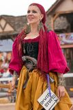 Jousting Event Renaissance Wench. A wench at the jousting event welcomes visitors to the Arizona Renaissance Festival Royalty Free Stock Image