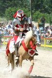 Jousting Knight. A Colorado Renaissance Festival performer during the jousting competition. The Colorado Renaissance Festival features a cast of hundreds of Stock Photography