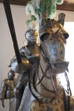 The jousting knight armor and a horse. A picture from Coburg Castle in Bavaria, Germany featuring a suit of full plate knight armor with a jousting lance placed Royalty Free Stock Photography