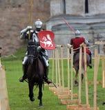 Jousting Knight On Horseback Stock Photo