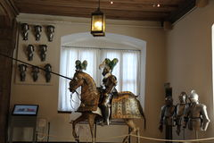 A jousting knight in shining patterned armor Royalty Free Stock Photo