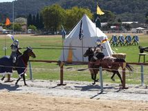 Jousting Knights. Knights on horseback charging each other Royalty Free Stock Image