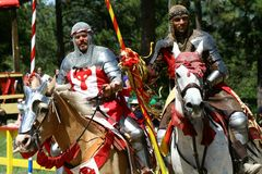 Jousting Knights. Colorado Renaissance Festival performers prepare for the jousting competition. The Colorado Renaissance Festival features a cast of hundreds of Royalty Free Stock Images