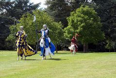Jousting knights, warriors, fighters riding horses. In a show or an event Royalty Free Stock Photo