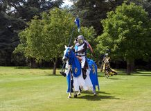 Jousting knights, warriors, fighters riding horses. In a show or an event Royalty Free Stock Photos