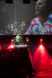 Jovanotti at the drums. The italian singer Lorenzo 'Jovanotti' Cherubini playing drums while a cameraman videotapes him on the maxi screen (notice the augmented Stock Image