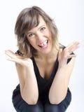 Jovem mulher agradável real na expressão engraçada foto de stock