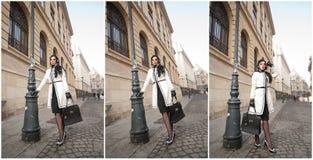 Jovem mulher atrativa em um tiro da forma do inverno Moça elegante bonita no equipamento preto e branco que levanta na avenida Imagem de Stock Royalty Free