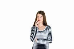 Jovem mulher atrativa profundamente em seus pensamentos Foto de Stock Royalty Free