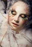 A jovem mulher bonita com criativo compo Fotos de Stock