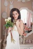 Jovem mulher bonita com flores. Retro denominado Fotografia de Stock