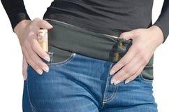 Mulher com rolo do euro 50 no bolso lateral isolado Fotos de Stock Royalty Free