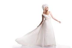 A jovem mulher bonita em um vestido de casamento Imagem de Stock