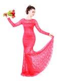 Jovem mulher bonita em um vestido de noite vermelho Imagens de Stock