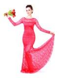 Jovem mulher bonita em um vestido de noite vermelho Foto de Stock Royalty Free