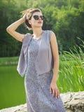 Jovem mulher bonita em um vestido do verão Imagem de Stock Royalty Free